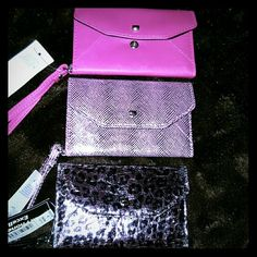 FLASH SALE3 Shades of Pink Samsung Galaxy S4 Wristlet Trip Fold WALLET S4 Phone Case. Metallic Leopard Pink/Blk, Metallic Snake Print Pink/Gray, Hot pink. Place to put Credit cards and lisence and a little cash. All have wrist holders. Brand new never used. Keeps your phone very safe. ?? Accessories Phone Cases