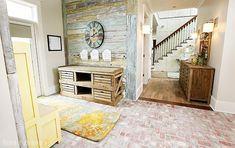 Entryway with reclaimed wood furniture