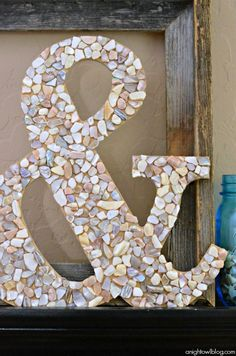 This pretty little ampersand would be perfect for your summer beach-themed mantel or your growing gallery wall! Follow this quick tutorial to create the project!