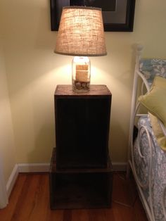 Bed side table in guest room from old milk crates and a lamp made from an old mason jar with a new burlap shade.