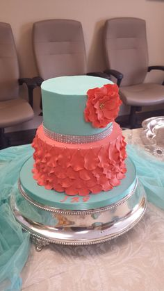 Turquoise and coral petal cake - Buttercream cake with fondant petals. Design by A Twist of Cake
