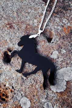 """Horse necklace, of Icelandic horse doing the """"tölt"""". Made with plexiglass by EYELOVE HORSES, check out more jewelry and organic clothes  www.eyelovehorses.com"""