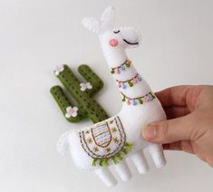 Sewing Gifts Hand sewn llama and cactus patterns made using craft felt and embroidery floss. Suitable for beginners! - This listing is for a felt llama (or alpaca, if you prefer) and flowering cactus hand sewing pattern. Hand Embroidery Stitches, Hand Embroidery Designs, Embroidery Ideas, Embroidery Scissors, Embroidery Tattoo, Geometric Embroidery, Embroidery Sampler, Felt Embroidery, Hardanger Embroidery
