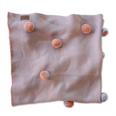 SOLD OUT (other colours available) Kip & Co Tiny | Merino Wool Pom Pom Baby Blanket in Peach. A fun and functional gift for a new baby #youngwillow #kipandco #babyblanket