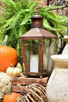 Fall decorating ideas from #bevolo: combine colors and textures to create interesting arrangements.  #fall #decorating #decor #lanterns
