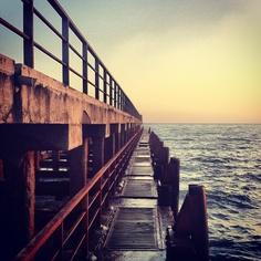 pier geometric form sunset sun black sea horizon.  sochi russia
