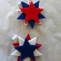 July 4th hair clips for my 8 month old granddaughter.  Stack pre cut (buy at craft store) felt stars on top of each other and hot glue.  Cover with ribbon or buy pre covered hair clips.  Hot glue the hair lip to the back of the stars.  Clip in the hair or on a headband