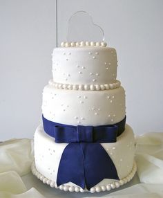 three tier modern wedding cake with purple bow by ArtisanCakeCompany, via Flickr