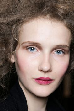 Romantic makeup with a rosy stained lip and flushed cheeks—like a porcelain doll or a Renaissance painting. | The 50 Best Beauty Looks from Fall 2016 Fashion Month | @stylecaster