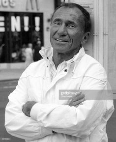 Portrait of American playwright and theatre director Arthur Laurents as he poses across the street from