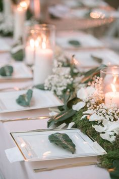 Rustic Wedding Table Setting with White Candles, Ivory Rose Petals, Baby's Breath and Greenery | Tampa Bay Wedding Floral Designer Northside Florist