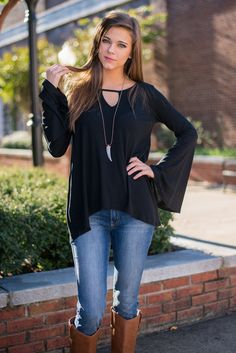 This top will be as close to your heart as any blouse can be!!! The fit and silhouette are insanely beautiful! AND... as if you needed another reason to love this blouse, it has bell sleeves!  Material has a generous amount of stretch. Miranda is wearing the small. Sizes fit: Small- 0-4; Medium- 6; Large- 8-10
