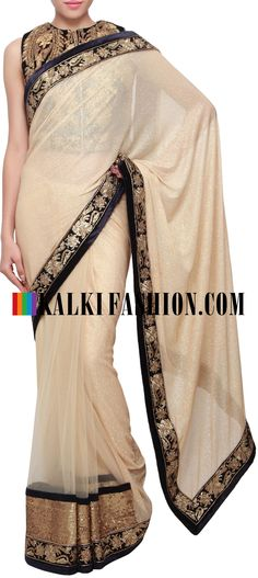 Buy Online from the link below. We ship worldwide (Free Shipping over US$100) http://www.kalkifashion.com/half-and-half-saree-in-beige-enhanced-in-kundan-embellished-border-only-on-kalki.html