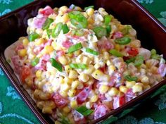 Ingredients     	1 (15 ounce) cans of drained whole kernel corn.   	1 medium seeded and diced tomato.   	2 tbsps of chopped green onion.   	⅓ cup of mayonnaise.   	½ tsp of dried basil (optional).   	Salt and pepper.      Directions  In