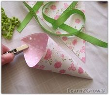 How to make May Day baskets. I remember making these in grade school. Then we would go out and deliver them around town. Who wouldn't want to come home fromwork to find a May day cone filled with flowers (sometimes real sometimes made from tissue paper) hanging from thier front door?