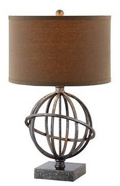 Add modern flair to your living room or den with this Lichfield table lamp. Its steel base features an atom-like orb with an antiqued tin finish for a majestic, sculptural feel. And the drum-style hardback lampshade features deep khaki fabric for a sleek, complementary aesthetic.
