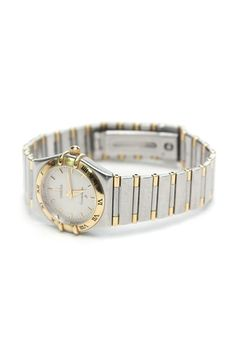Authentic Omega two-tone stainless steel Constellation women's watch (style 13723000). Features a stainless steel and gold plated watch case and bracelet, silver patterned dial, a scratch-resistant sapphire crystal, and a folding clasp bracelet closure. Swiss quartz movement. Water resistant to 30m. Includes Omega watch case, instruction booklet, warranty card, and spare links (2).  Authenticity/Serial #: 56442105.