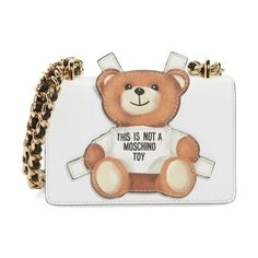 small fantasy bear shoulder bag by Moschino. Moschino's lovable mascot is all dolled up on this compact shoulder bag featuring a curb chain strap that can be pull...