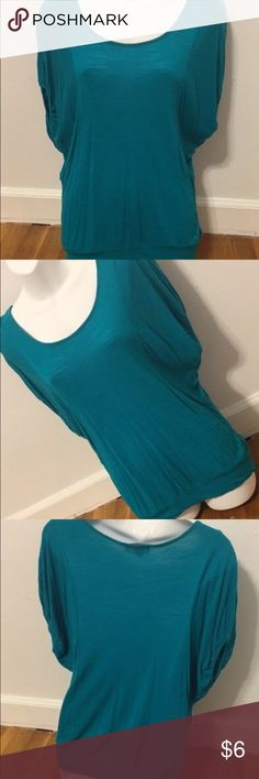 Forever 21 Teal Shirt Teal Forever 21 tshirt. Hangs off the shoulders slightly. Super cute shirt. Great condition. Size small. Forever 21 Tops Tees - Short Sleeve
