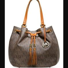 Michael Kors handbag Brown Michael Kors bag with the MK logo. Two tassels in the front with the gold hardware. Inside zipper pocket as well as two smaller pockets. Michael Kors Bags Shoulder Bags