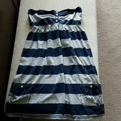 Abercrombie & Fitch knit strapless dress Striped strapless top that can be used as a tunic top over leggings or can be used as a bathing suit cover up at the beach. 2 front pockets. Ties in the back..really cute top! Smoke free home Abercrombie & Fitch Dresses Mini