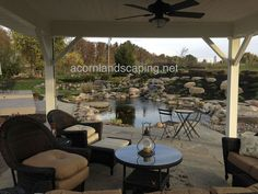 Gorgeous Ecosystem Waterfall Garden Pond, Monroe County, Rochester, NY  Check out this Outdoor Living area with Ecosystem Pond, Waterfalls, Lighting, Plantings,…