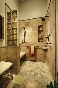 Travertine tile universal design bathroom.