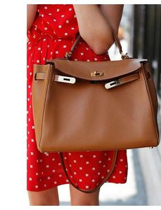 Hermes Kelly bag in classic tan - so chic. Maybe one day...
