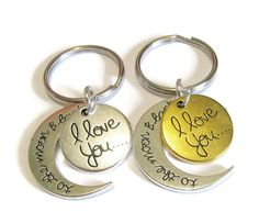 This listing is for 2 i love you to the moon & back keychains. Each come in their own little gift box. Please check out my shop here for many other fun styles and selections https://www.etsy.com/shop/CharminTreasureChest  If you need more of any item or any adjustments made,