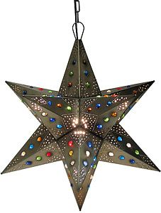 These handmade hanging tin stars from Mexico are the ultimate accent to your rustic or southwestern decor!  The various punched out designs and colorful marbles are absolutely stunning when illuminated and glow from every angle of the four-sided arms.  Hang one in any room of your home for unique decorative lighting.  Available in small and large sizes below.