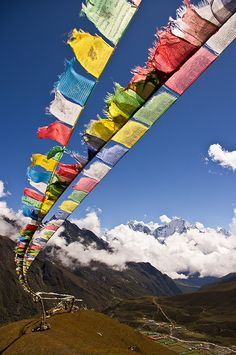 Prayer flags, I believe in the power of a though, so I believe in the power of a prayer...and I love the visual that your pray is being carried through the wind, reaching where ever it may go, in the hopes that it  can magically come back to you, turning your prayer dreams, hopes, and wishes and make them a reality. Don't you love that, if only life was that simple ;)