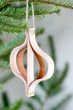 This Rustic Leather DIY Christmas Ornament is the perfect Christmas stocking stuffer for the cowboy or cowgirl in your life.