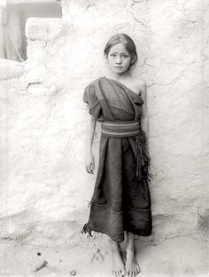 Young Hopi girl standing outside, Oraibi, Arizona, ca.1900. Photo by C.C. Pierce. Source - University of Southern California Libraries.
