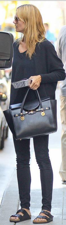 heidi klum Who made Heidi Klums black tote handbag and flat sandals?