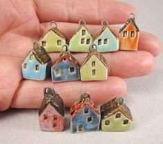 Hand formed tiny stoneware house charms/pendants - pairless leftovers from jewelry projects. Textured roofs, stamped windows and doors.