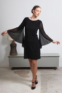 Day and night black dress with wide bell sleeves by elbling, $90.00
