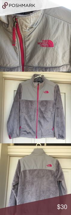 Grey North Face Liner with pink highlights It is a girls large but fits a woman's xs. In good condition and from a smoke free home! Small mark on the back (shown in picture) North Face Jackets & Coats
