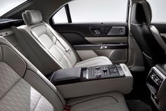 Lincoln Continental - Rear seat passengers have access to climate control and audio controls