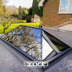 XACT Pure Glass Roof Lantern. The only truly frameless and thermally broken roof lantern. Modern contemporary style. Perfect for a flat roof single storey rear extension.