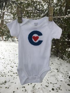 A personal favorite from my Etsy shop https://www.etsy.com/listing/498588851/chicago-cubs-onesie-chicago-love-onesie