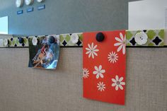 Tutorial for magnetic photo strip made with a metal ruler. Perfect way to spruce up a cubicle.