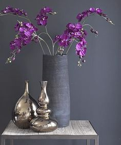grey textural vase with purple orchids has a Japanese inspired look
