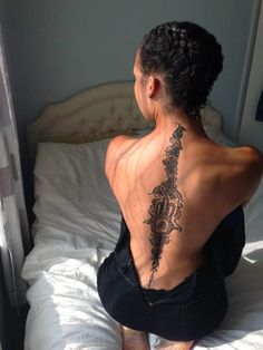 Spine Tattoos and Designs: - Show the world why you were born.