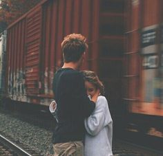 """(Open RP: Be the brother?) We're running away from home. Our parents beat us and were planning to send us away to live with our even crueler uncle. We need to reach our older brother who's in college so he can protect us. As we're walking, I trip on the train tracks. My foot gets stuck. We hear the train coming in the distance. """"Y/n!"""" I yell. """"Help!"""" (Be the brother in the picture. Her name is Alice. They don't get along and they're currently mad at each other) Give credit to me if re-posted…"""