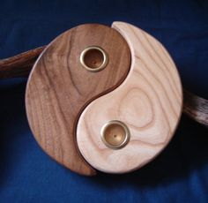 Yin Yang candle holder crafted from reclaimed lumber
