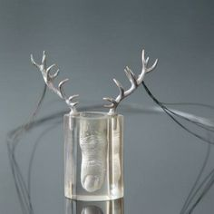 """ANDRZEJ BOSS-PL Pendant, 2007   silver, steel, resin """"Artist bother problems of the modern world, dominated by the media and advertising, commercialism, which is in constant pursuit of youth and spurious perfection"""""""