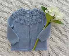 Inspired by vintage style, the Sunday Morning Cardigan features a sweet lace yoke and gently gathered sleeve cuffs. The classic and feminine design will look darling on any little girl. Knit seamlessly from the bottom up, the knitter will only need to graft the underarm stitches. The pattern includes a tutorial for the Kitchener stitch used to graft the underarm. The lace pattern is a simple, easy-to-memorize repeat with the yoke decreases worked in the garter stitch rows. This makes this…