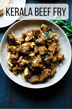 Tender chunks of beef are slow roasted in a mix of spices, coconut slivers, curry leaves and onions to make this Kerala style dish of beef fry. Kerala beef fry is also called Beef Ularthiyathu… More Steak Dinner Recipes, Steak Recipes, Best Indian Recipes, Ethnic Recipes, Kerala Recipes, Cooking Curry, Pinterest Recipes, Pinterest Food, Kerala Food