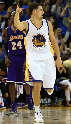 Description of . Golden State Warriors' Klay Thompson (11) celebrates after scoring a three point shot past Los Angeles Lakers' Kobe Bryant (24) in the fourth quarter of their game at Oracle Arena in Oakland, Calif., Saturday, Nov. 1, 2014. (Anda Chu/Bay Area News Group)