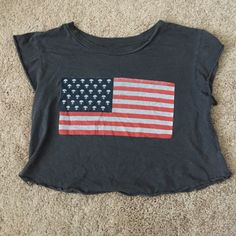 brandy melville alien flag crop top i believe this is the elin style of top from brandy. im kinda over crop tops which is why im selling. brandy is one size fits most but this would best fit an xs/s. Brandy Melville Tops Crop Tops